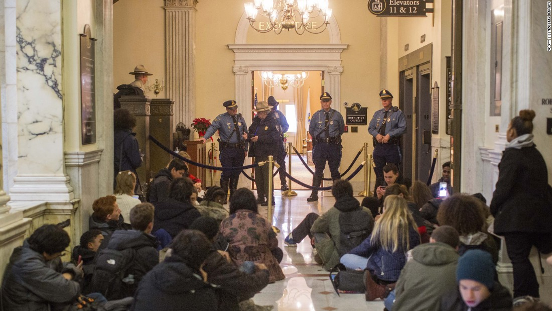 "Boston-area students sit on the floor after being blocked from entering the governor's office at the Massachusetts State House in Boston on Monday, December 5. <a href=""http://www.necn.com/news/new-england/Boston-Students-Plan-Walk-Out-to-Protest-Trump-404725155.html"" target=""_blank"">According to a local news outlet</a>, students were demanding that their state leaders stand up to some of the proposed policies and statements President-elect Trump has made."