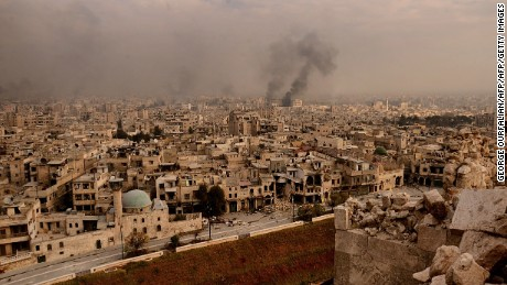TOPSHOT - A general view taken from Aleppo's citadel show fumes rising following shelling on neighbourhoods in the old city on December 7, 2016. / AFP / GEORGE OURFALIAN        (Photo credit should read GEORGE OURFALIAN/AFP/Getty Images)