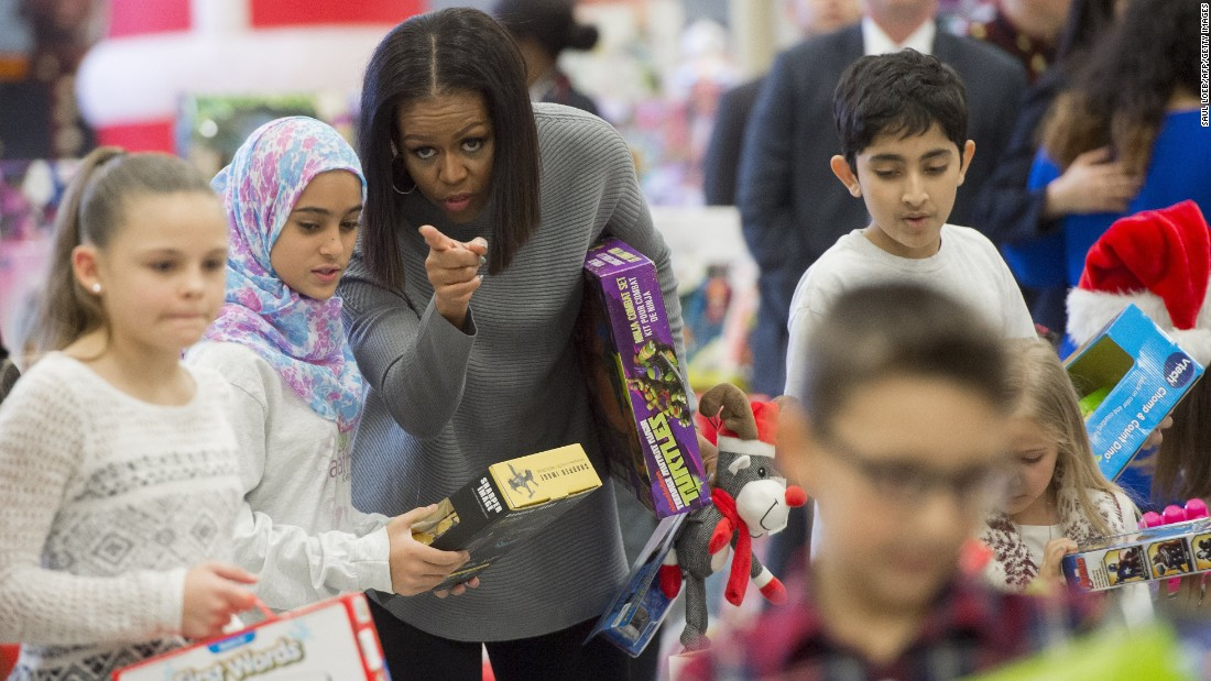 First lady Michelle Obama helps sort donated toys during the Marine Corps Reserve Toys for Tots program in Washington on Wednesday, December 7.  The program's mission is to collect new, unwrapped toys and deliver them to less fortunate children throughout the United States during the holiday season.