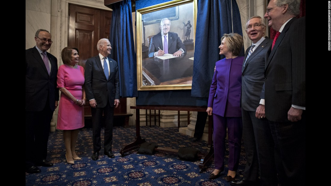 Senate Minority Leader Harry Reid, second from right, stands by his official portrait during a ceremony on Capitol Hill in Washington on Thursday, December 8. Reid marked the end of his 34-year career in Congress with the unveiling of his official portrait, painted by former Senate staffer Gavin Glakas.
