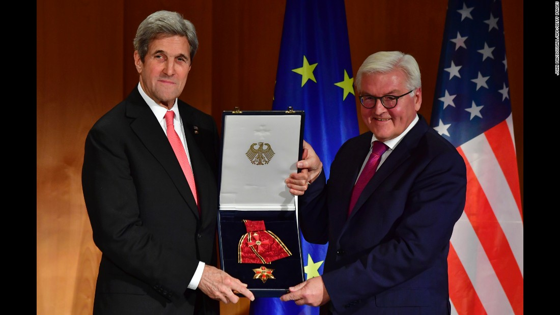 German Minister for Foreign Affairs Frank-Walter Steinmeier, right, awards US Secretary of State John Kerry the Grand Cross of the Order of Merit in Berlin, Germany, on Monday, December 5.