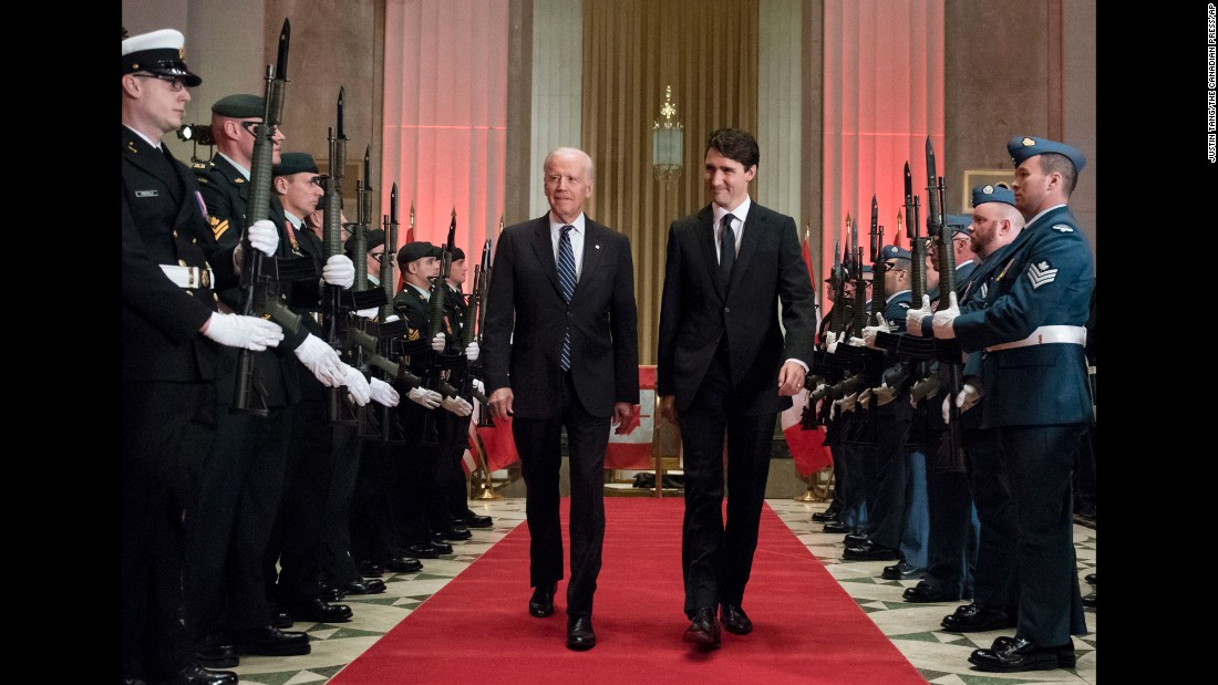 "Canadian Prime Minister Justin Trudeau, right, and US Vice President Joe Biden arrive at a state dinner in Ottawa, Canada, on Thursday, December 8. ""The world is going to spend a lot of time looking to you, Mr. Prime Minister,"" <a href=""http://bigstory.ap.org/article/2ebf67cbc4524a78978c07bec21c6e9d/bidens-tribute-tour-moves-north-canada"" target=""_blank"">Biden told a crowd of Canadian dignitaries</a>. ""Viva la Canada because we need you very, very badly."""