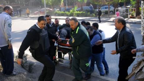 Emergency services transport a bomb attack victim west of Cairo.