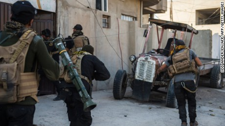 Iraqi Special Forces 2nd division soldiers run to enter a house as they push forward in the Karkukli neighbourhood in Mosul on November 13, 2016 during the ongoing operation to retake the city from the Islamic State (IS) group. Iraqi Special Forces 2nd division continued to battle IS forces as they pushed through the Arbagiah area and into the neighbourhood of Karkukli.   / AFP / Odd ANDERSEN        (Photo credit should read ODD ANDERSEN/AFP/Getty Images)