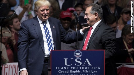 President-elect Donald Trump introduces Andrew N. Liveris, chief executive officer of The Dow Chemical Company and Trump's choice to be the head of a national manufacturing council, at the DeltaPlex Arena, December 9, 2016 in Grand Rapids, Michigan.