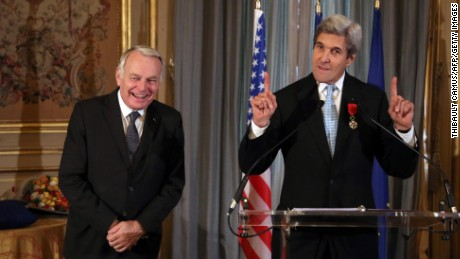 Secretary of State John Kerry and France's Jean-Marc Ayrault share a light moment Saturday in Paris.