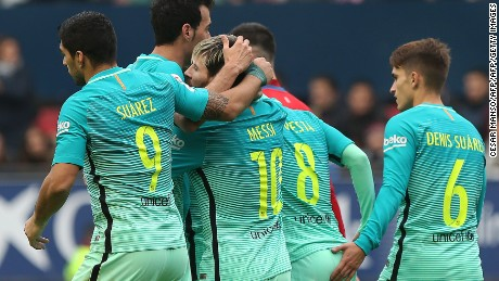 Barcelona's Argentinian forward Lionel Messi (3L) celebrates with teammates during the Spanish league football match CA Osasuna vs FC Barcelona at the Reyno de Navarra (El Sadar) stadium in Pamplona on December 10, 2016. / AFP / CESAR MANSO        (Photo credit should read CESAR MANSO/AFP/Getty Images)
