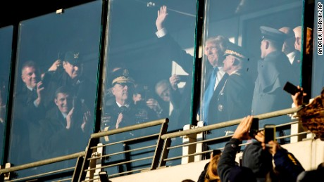 President-elect Donald Trump waves from the Army side during an Army-Navy NCAA college football game at M&T Bank Stadium, Saturday, Dec. 10, 2016, in Baltimore. (AP Photo/Andrew Harnik)