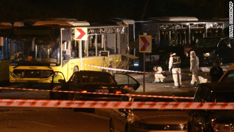 Forensic officials work at the scene of explosions near a stadium in Istanbul.