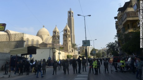 Egyptian security forces gather at the site of an explosion at the Saint Mark's Coptic Orthodox Cathedral on December 11, 2016 in the Abbasiya neighbourhood in the capital Cairo. Copts, who make up about 10 percent of Egypt's population of 90 million, have faced persecution and discrimination that spiked during the 30-year rule of Hosni Mubarak, who was toppled by a popular uprising in 2011. / AFP / KHALED DESOUKI        (Photo credit should read KHALED DESOUKI/AFP/Getty Images)