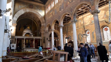 Security officials and people inspect the damage inside St. Peter and St. Paul Coptic Orthodox Church after a bombing in Cairo, Egypt, 11 December 2016.