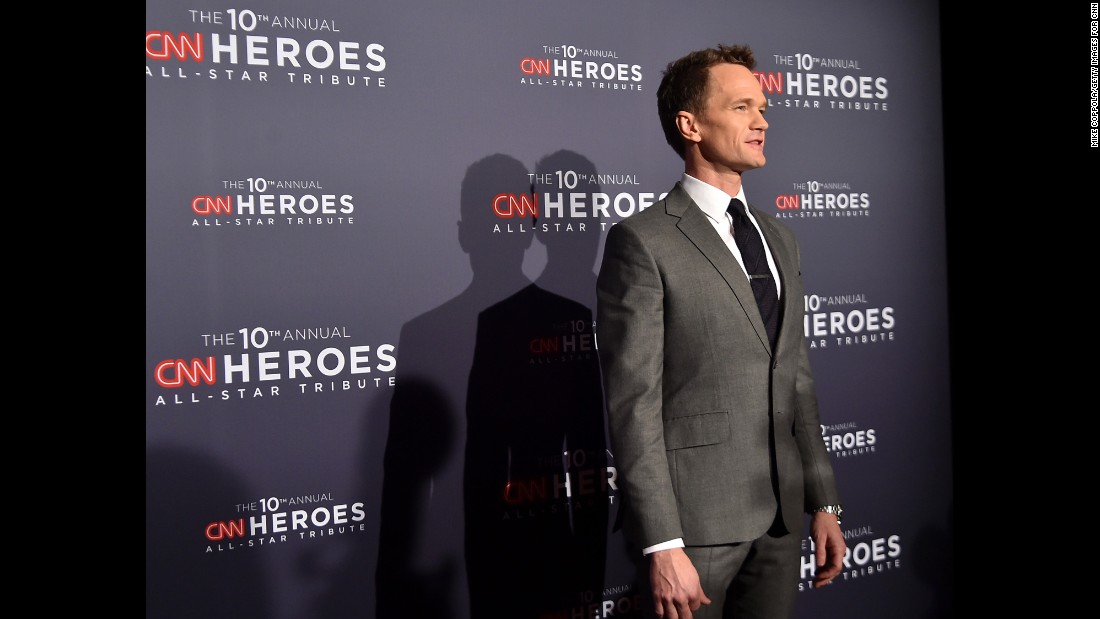 Actor Neil Patrick Harris poses for photos on the CNN Heroes red carpet.