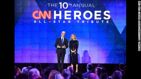 NEW YORK, NY - DECEMBER 11:  Hosts Anderson Cooper and Kelly Ripa speak onstage during the CNN Heroes Gala 2016 at the American Museum of Natural History on December 11, 2016 in New York City.