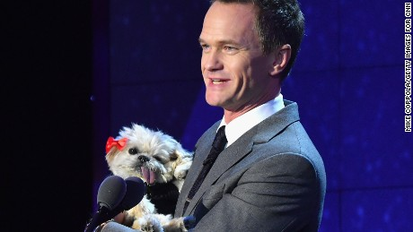 NEW YORK, NY - DECEMBER 11:  Neil Patrick Harris wirth a dog, speaks onstage during the CNN Heroes Gala 2016 at the American Museum of Natural History on December 11, 2016 in New York City. 26362_011  (Photo by Mike Coppola/Getty Images for Turner)