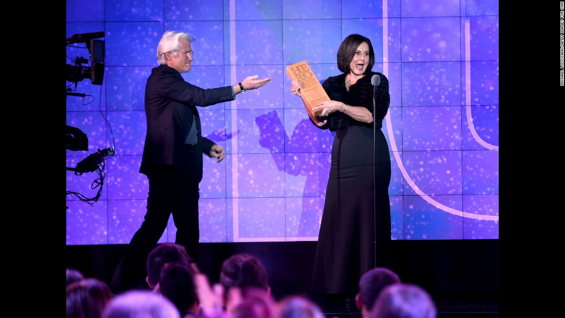 "CNN Hero Georgie Smith of<a href=""http://www.cnn.com/2016/06/09/us/cnn-heroes-georgie-smith/index.html"" target=""_blank""> A Sense Of Home</a> accepts her award from presenter Richard Gere. Smith helps former foster kids establish a home all their own after they age out of the Los Angeles foster care system."