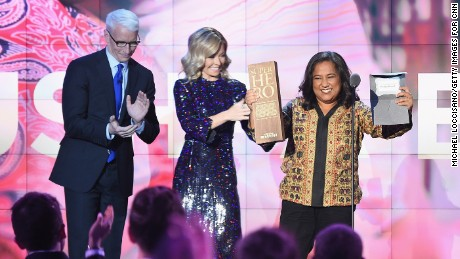 NEW YORK, NY - DECEMBER 11:  Anderson Cooper and Kelly Ripa present an award to CNN Superhero and 2012 CNN Hero of the Year Pushpa Basnet onstage during the CNN Heroes Gala 2016 at the American Museum of Natural History on December 11, 2016 in New York City.26362_013  (Photo by Michael Loccisano/Getty Images for Turner)