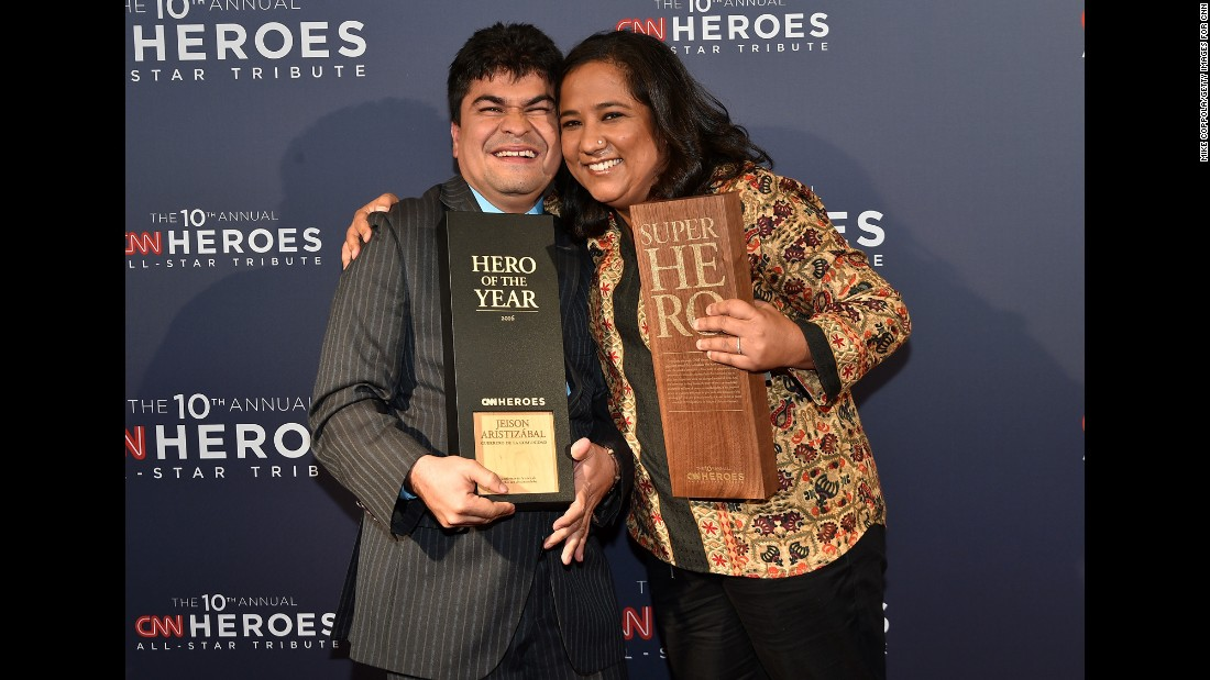 "CNN Superhero and 2012 CNN Hero of the Year Pushpa Basnet, right, poses with 2016 CNN Hero of the Year Jeison Aristizábal after Sunday's ""CNN Heroes: An All-Star Tribute."""