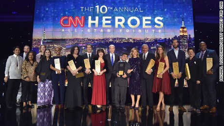 NEW YORK, NY - DECEMBER 11: (L-R) Efren Penaflorida, Brad Ludden, Pushpa Basnet, Liz McCarthey, Umra Omar, Georhie Smith, Chad Pregracke, Sherri Franklin, Anderson Cooper, Jeison Aristizabal, Kelly Ripa, Harry Swimmer, Becca Stevens, Craig Dodson, Luma Mufleh, and Sheldon Smith pose onstage during the CNN Heroes Gala 2016 at the American Museum of Natural History on December 11, 2016 in New York City.