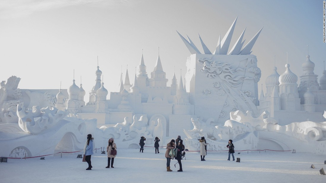 At the annual event, landmarks and buildings from around the world are reconstructed in ice. Snow sculptures like this one also feature.