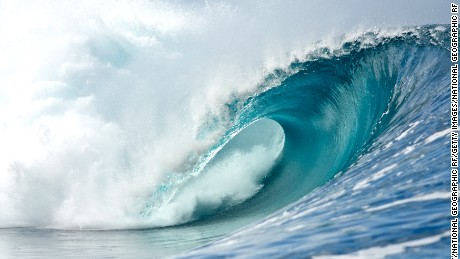 A perfect waves breaks in Teahupoo, Tahiti showing the tube.