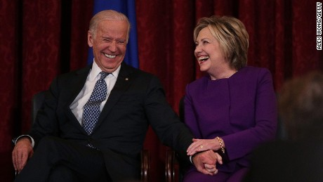 Hillary Clinton shares a moment with Vice President Joe Biden on December 8, 2016, on Capitol Hill.
