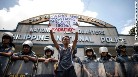 A activist hold a banner in front of Philippine National Police (PNP) headquarters during a protest condemning what they call extra-judicial killings related to President Rodrigo Duterte's campaign against drugs, in Manila on August 24, 2016. Nearly 2,000 people have been killed since Duterte was sworn into office on June 30, 2016 and immediately launched his war on crime, according to the national police chief.  / AFP / NOEL CELIS        (Photo credit should read NOEL CELIS/AFP/Getty Images)
