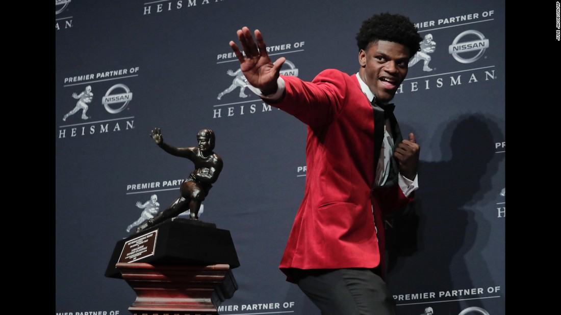 "Louisville quarterback Lamar Jackson poses with the Heisman Trophy <a href=""http://www.cnn.com/2016/12/10/sport/heisman-trophy/index.html"" target=""_blank"">after winning the award</a> in New York on Saturday, December 10.  Jackson, a sophomore who scored 51 touchdowns this year and amassed 4,928 yards of total offense, is the youngest player ever to win the award. He is also the first player in Louisville history to win it."