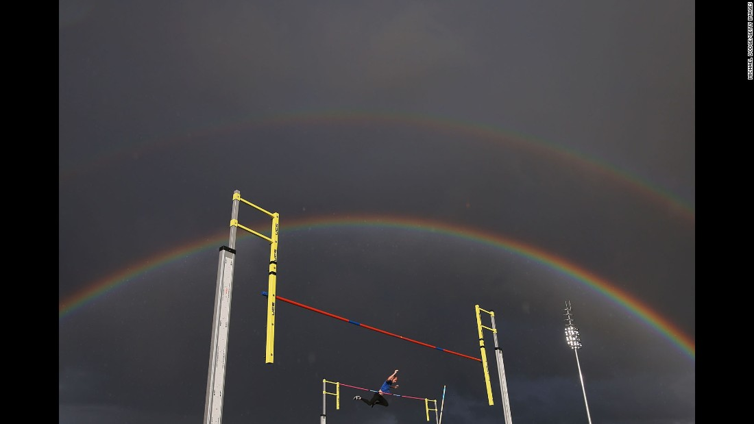 A rainbow appears over a pole vaulter during a competition in Melbourne on Thursday, December 8.
