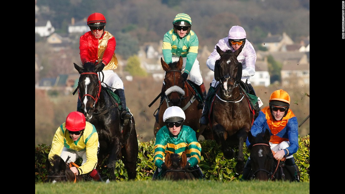 Mark Walsh, center front, rides Cantlow to a steeplechase win in Cheltenham, England, on Friday, December 9.
