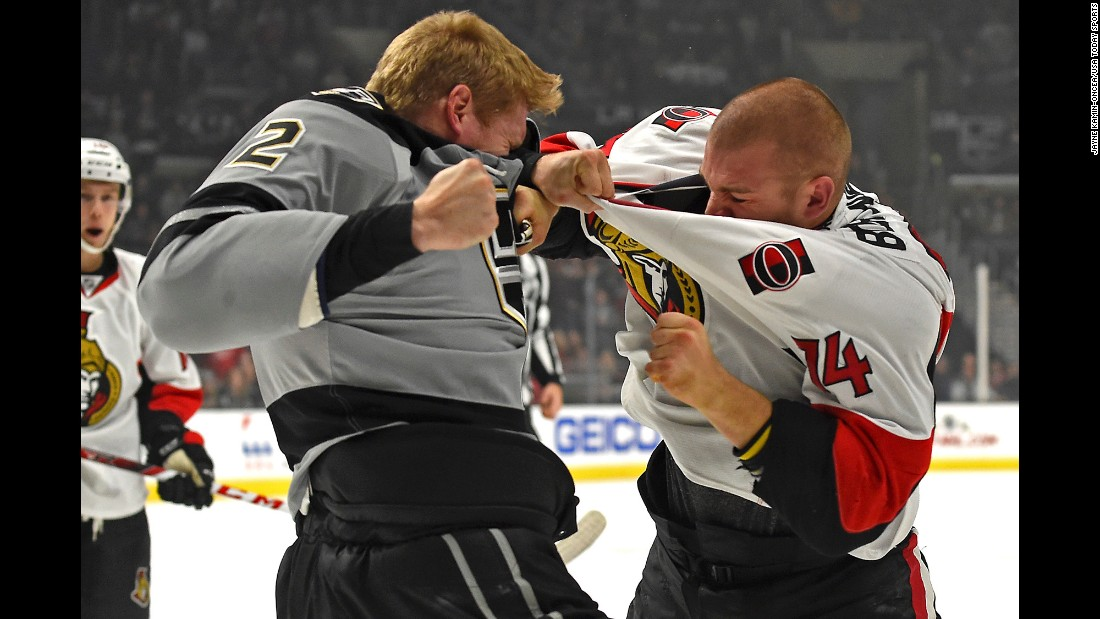 Los Angeles defenseman Matt Greene, left, fights Ottawa defenseman Mark Borowiecki during an NHL hockey game on Saturday, December 10.