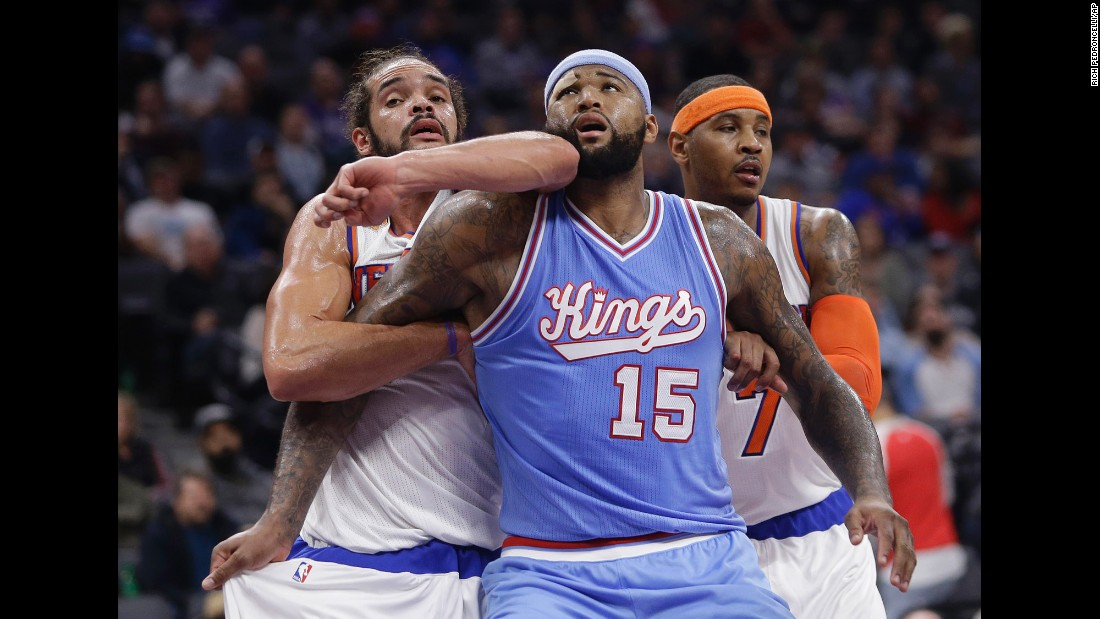 New York's Joakim Noah, left, battles DeMarcus Cousins for a rebound during an NBA basketball game in Sacramento, California, on Friday, December 9.