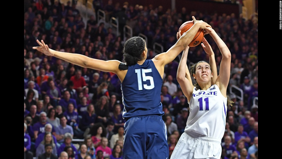 Connecticut guard Gabby Willams, left, blocks the shot of Kansas State forward Peyton Williams during a college basketball game in Manhattan, Kansas, on Sunday, December 11.