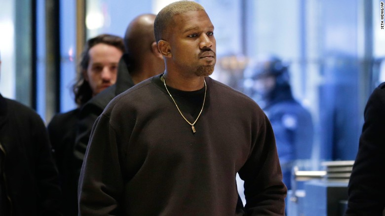 Kanye West enters Trump Tower in New York, Tuesday, Dec. 13, 2016. (AP Photo/Seth Wenig)