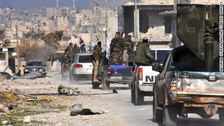 TOPSHOT - Syrian pro-government forces patrol Aleppo's Sheikh Saeed district, on December 12, 2016, after troops retook the area from rebel fighters. / AFP PHOTO / GEORGE OURFALIANGEORGE OURFALIAN/AFP/Getty Images