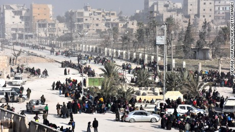 Syrian civilians arrive at a pro-government checkpoint after leaving Aleppo's eastern neighbourhoods on Saturday.
