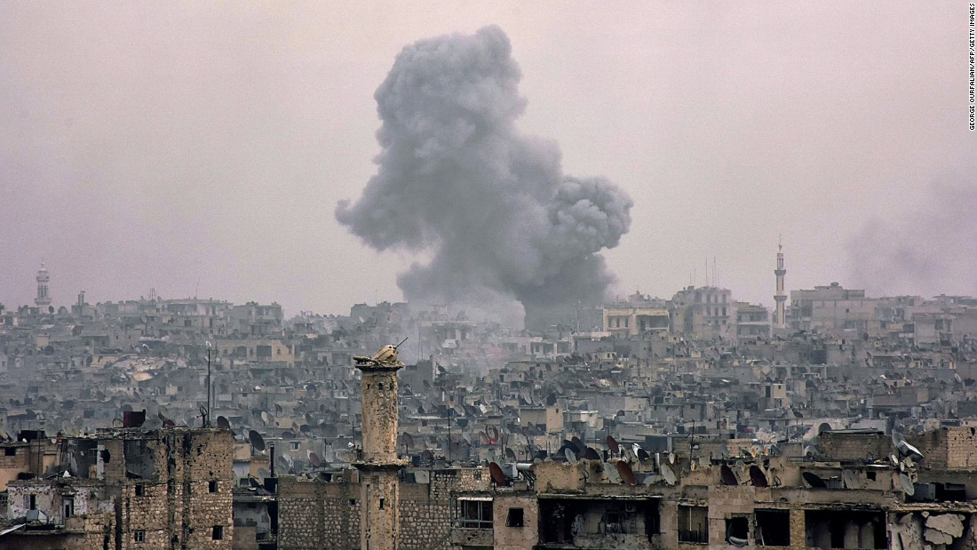 Clouds of smoke billow from eastern Aleppo's al-Shaar neighborhood on Monday, December 5.