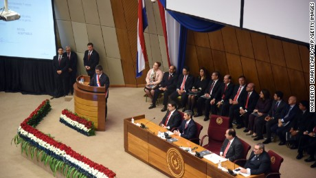 Paraguay's President Horacio Cartes (L, on stand) delivers his annual report to the nation before the National Congress in Asuncion in July 1, 2015.  AFP PHOTO / NORBERTO DUARTE        (Photo credit should read NORBERTO DUARTE/AFP/Getty Images)