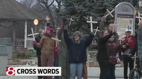 Residents have started bringing their own crosses to the town square in protest.