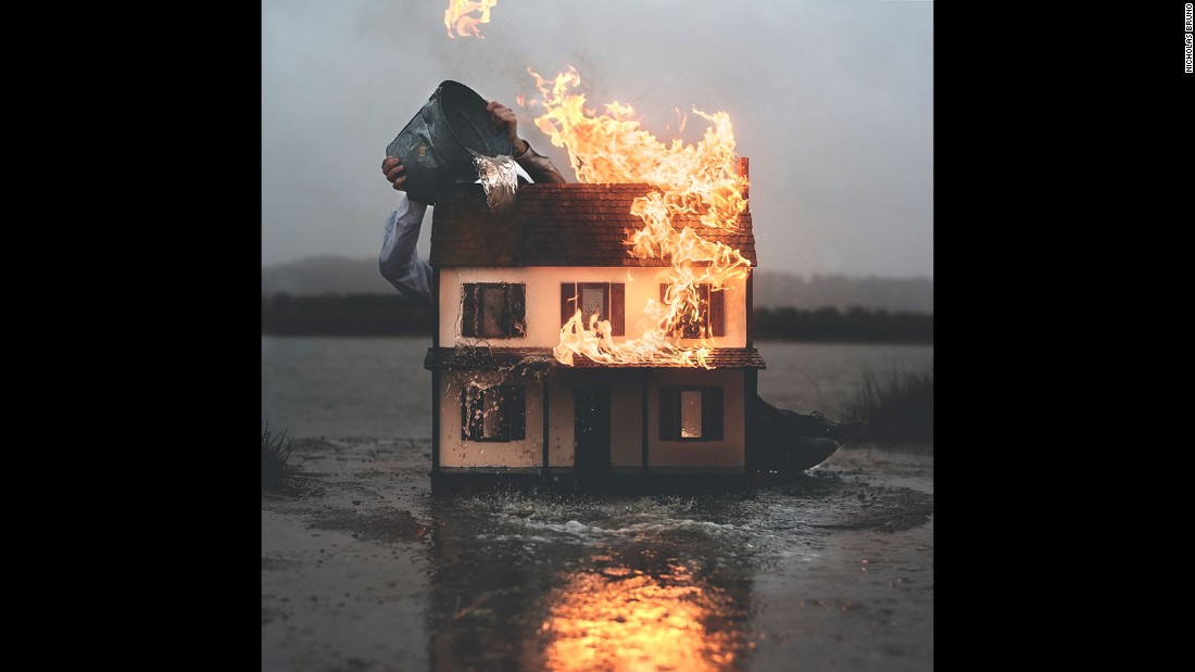 """Boom, you just woke up and what's going on? Or boom, you just woke up and your house is on fire. It's that quick anxiety,"" Bruno explains. ""The most recent image that I shot, I burned a doll house. It's me trying to extinguish the immediate effect of what's going on."""