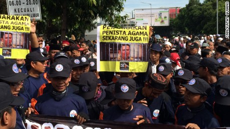 Anti-Ahok protestors gather outside a Central Jakarta courthouse, where the mayor is on trial for blasphemy.