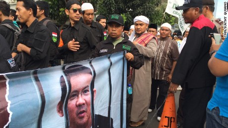 Anti-Ahok protestors gather outside a central Jakarta courthouse for the beginning of the mayor's blasphemy trial.