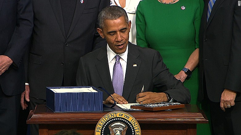 Obama signs cancer research bill