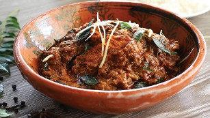 Peppermill's Chicken Chettinad offers a south Indian style boneless chicken curry with blended spices and coconut.