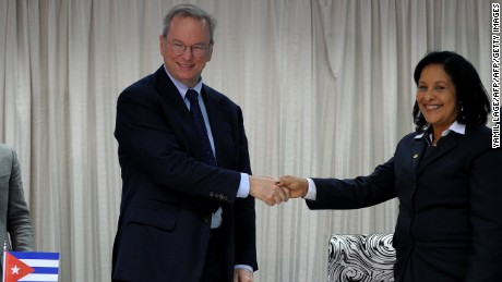Google Executive Chairman Eric Schmidt (L) and Cuban national telecom provider (ETECSA) president executive Mayra Arevich shake hands after the signing of a bilateral agreement in Havana, on December 12, 2016.  / AFP / YAMIL LAGE        (Photo credit should read YAMIL LAGE/AFP/Getty Images)
