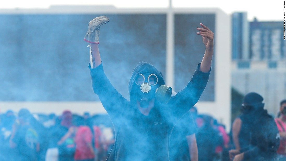 A protester gestures in front of the National Congress in Brasilia on December 13.