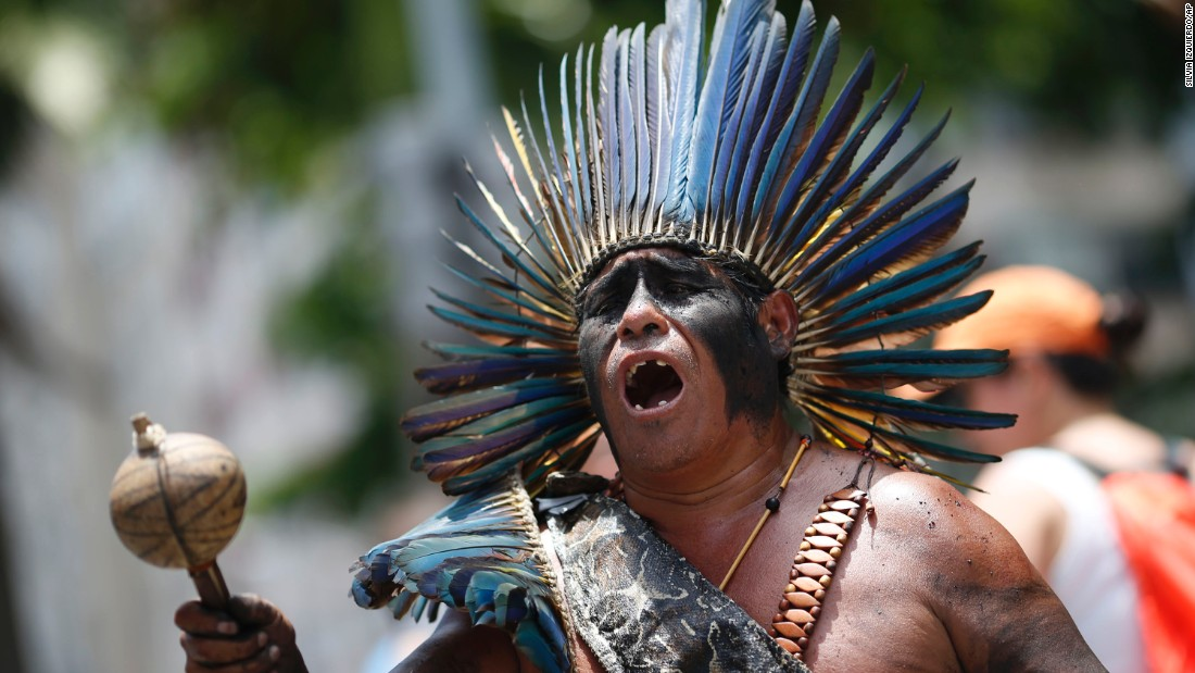 An indigenous man sings during a rally in Rio de Janeiro on December 12.