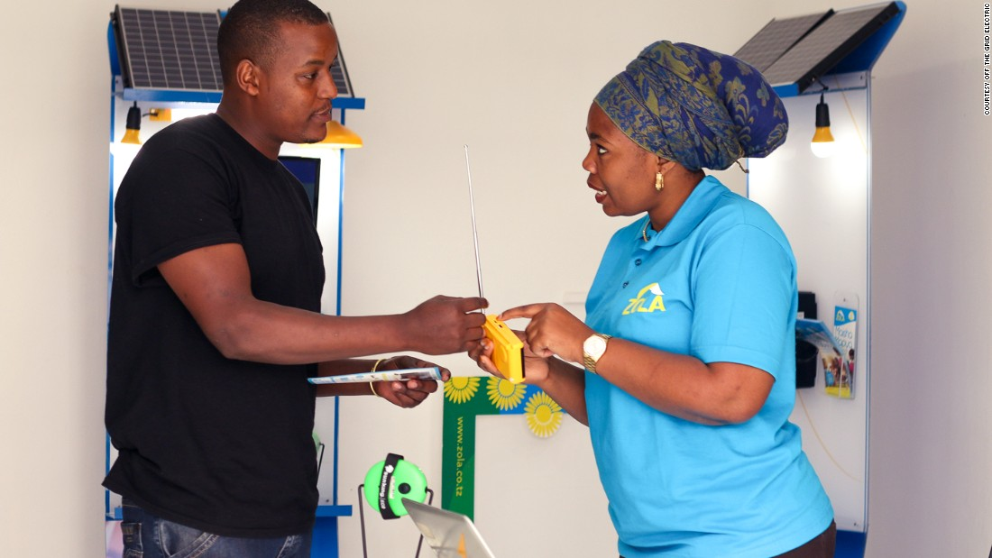 A Zola Retail Officer demos the Zola radio to a potential customer in a flagship retail shop.