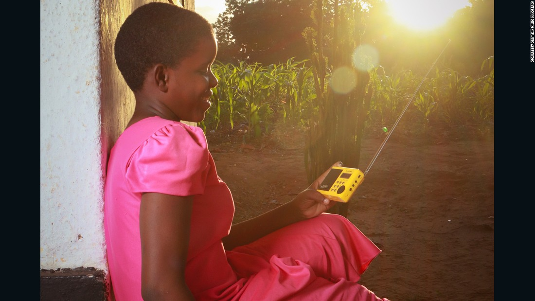 A young Tanzanian girl enjoys music in Tanga region from a solar powered radio.