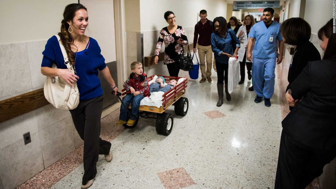 Nicole McDonald pulls Aza and the twins on December 13, on their way to the hospital's farewell party. It was the first time the twins left their hospital room for  anything other than a medical procedure.
