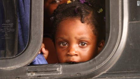 in Paso Canoas, Costa Rica, migrant child on bus waiting to be taken to a shelter